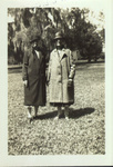 Alice Ellen and Clara Louise Guild outdoors, wearing coats and hats