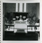 Altar and chancel of the 1939 brick church, Holy Week, c. 1940