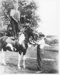 Andrew Duda, Jr. and older brother, John Duda, with horse, c.1917, Original Image