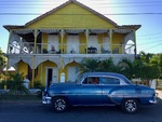 Vintage Car in front of Old House by Wendy S. Howard EdD