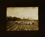 Large Family Posing in Crop Field