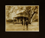 Man and Boy Standing in Front of House