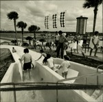 Visitors on a water slide at Wet'n Wild.