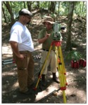 Archaeologist with total station by Michael Callaghan