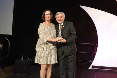 Kathie Canning receives award from Dr. Pizam 1