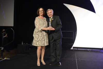 Kathie Canning receives award from Dr. Pizam 2