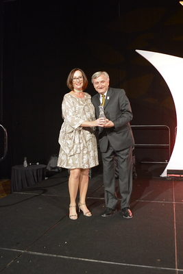 Kathie Canning receives award from Dr. Pizam 3