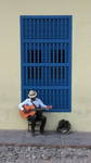 Guitarist Tuning his Instrument by Pratyush S. Goberdhan