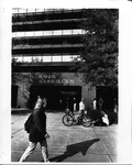 Business Administration I Building, student walking by entrance