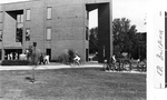 Education Building - students by bike rack and entrance