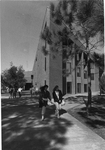 Education Building - two students leaving