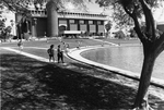 Library - students walking and on lawn in front of Reflecting Pond