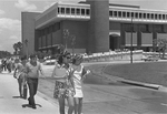 Library - students walk in front of Phillips Hall - 1970's