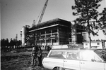 Library construction - station wagon and kids