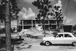 Library - Ford Falcon in front of construction