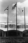 Millican Hall (the Administration Building), entrance area, with three flags