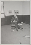 Millican, Charles - at desk with pipe